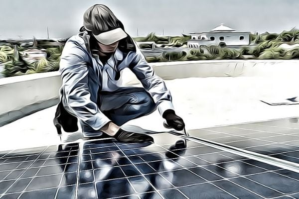 man working on solar panel array